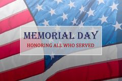 Text Memorial Day and Honor on flowing American flag background stock image
