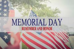 Text Memorial Day and honor on row of lawn American Flags. Text Memorial Day and honor on long row of lawn American Flags background. Green grass yard USA flags Royalty Free Stock Photography