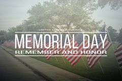 Text Memorial Day remember and honor on row of lawn American Fla royalty free stock photos