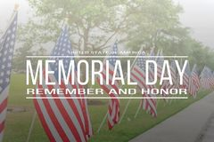 Text Memorial Day remember and honor on row of lawn American Fla royalty free stock images