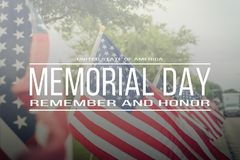 Text Memorial Day remember and honor on row of lawn American Fla royalty free stock photo