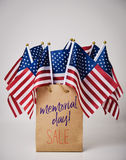 Text memorial day sale and american flags stock photography