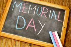 Text memorial day written with chalk in a chalkboard Stock Photo