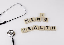 Text: MEN'S HEALTH from wooden letters on white office desk Royalty Free Stock Image