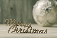 Text merry christmas and bauble Royalty Free Stock Photography