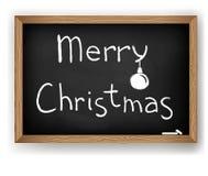 Text Merry Christmas on blackboard Stock Image