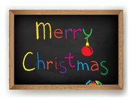 Text Merry Christmas on blackboard Royalty Free Stock Photo