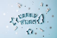 Text Merry Christmas on blue background Royalty Free Stock Image