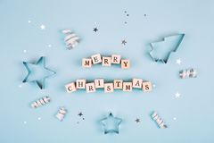 Text Merry Christmas on blue background Royalty Free Stock Photography