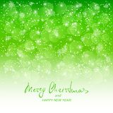 Text Merry Christmas and Happy New Year on green snowy background Royalty Free Stock Photo