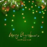 Christmas lights on green knitted pattern. Text Merry Christmas and Happy New Year with holiday decorations. Colorful Christmas lights with fir tree branches and Stock Photos
