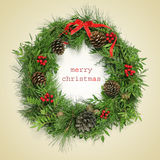 Text merry christmas and natural christmas wreath, with a retro Royalty Free Stock Photos