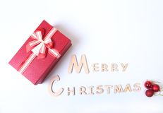 Text merry christmas on paper with many balls and gift box.  Stock Images