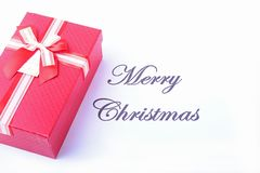Text merry christmas on paper with many balls and gift boxes Royalty Free Stock Image