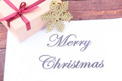 Text merry christmas on paper with many balls and gift boxes Stock Photography