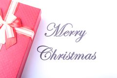 Text merry christmas on paper with many balls and gift boxes Stock Images