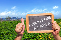 Text message - Countryside Holidays on a slate blackboard Stock Image