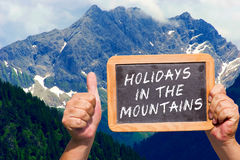 Text message - Holidays in the Mountains on a slate Royalty Free Stock Photography