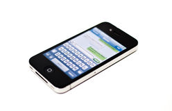 Text message on iPhone mobile phone. WASHINGTON, DC - March 19: An Apple iPhone 4 screen showing the SMS text messaging interface in Washington on March 19, 2012 Royalty Free Stock Image
