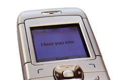 Text message of love. Mobile phone sending or receiving a text message saying 'I love you xXx royalty free stock image