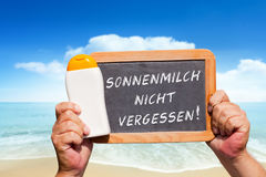 Text message - Sonnenmilch nicht vergessen on a slate Stock Photos