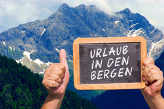 Text message - Urlaub in den Bergen on a slate Royalty Free Stock Images