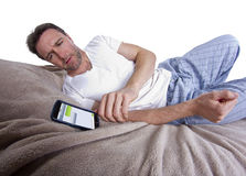 Text Messages in Bed Stock Photo