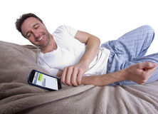 Text Messages in Bed Royalty Free Stock Images