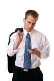 Text Messaging. A young man with his jacket over his shoulder sending a text message Stock Photography