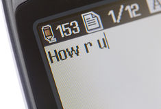 Text Messaging Mobile Phone. Close-up of text messaging on a mobile phone Royalty Free Stock Images