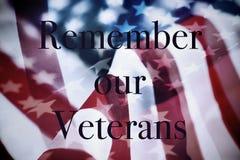 Text minns våra veteran och flaggan av USA royaltyfria bilder