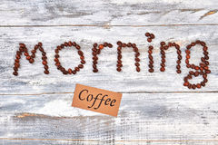 Text morning and paper. Inscription from coffee, wooden background Stock Photography