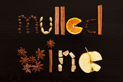 Text mulled wine made from slice of orange, spices on the black Stock Photography