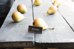 Text natural and Juicy flavorful pears. Natural food idea, Juicy flavorful pears on a wooden table Stock Photo