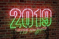 2019 text with neon lights 3d rendering. 2019 text with neon lights on a brick wall background, happy new year concept. 3d rendering vector illustration