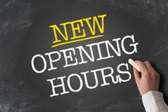 Free Text NEW OPENING HOURS Written On Chalkboard Stock Photo - 146910580