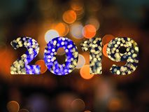 Text of 2019 new year with bokeh background. Text of 2019 new year with bokeh light background royalty free stock image