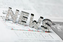 Text of 'news' with newspaper Stock Photo
