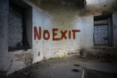 Text no exit on the dirty old wall in an abandoned ruined house Stock Images