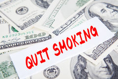 Free Text Of Quit Smoking With Dollars Money Stock Photography - 91946992