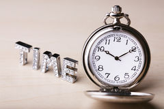Text Of  Time  With Pocket Watch Royalty Free Stock Images