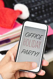 Text office holiday party in a smartphone Stock Photos