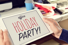 Text office holiday party on a tablet Stock Photos