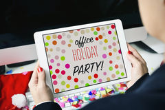 Text office holiday party in a tablet Royalty Free Stock Images