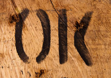 Text ok on wood Royalty Free Stock Photography