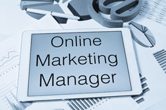 Text online marketing manager in the screen of a tablet Stock Photography