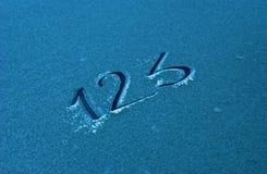Text 123 på en frost Arkivfoton