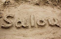 Text på sanden arkivfoto
