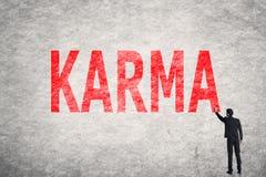 Text på väggen, Karma royaltyfri fotografi