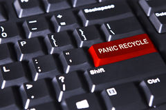 Text of panic recycles on the red button Stock Photography